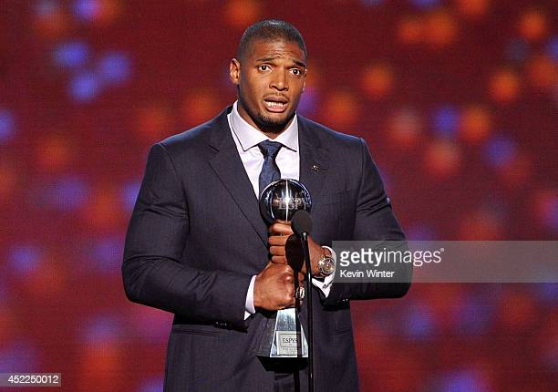 NFL player Michael Sam accepts the Arthur Ashe Courage Award onstage during the 2014 ESPYS at Nokia Theatre LA Live on July 16 2014 in Los Angeles...