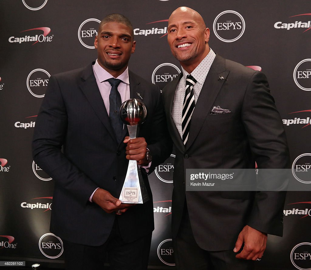NFL player Michael Sam with Actor Dwayne Johnson backstage with the award Arthr Ashe Courage Award at The 2014 ESPY Awards at Nokia Theatre L.A. Live on July 16, 2014 in Los Angeles, California.