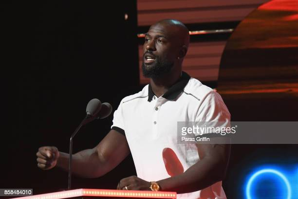 NFL player Michael Thomas presents the Album of the Year Award onstage during the BET Hip Hop Awards 2017 at The Fillmore Miami Beach at the Jackie...