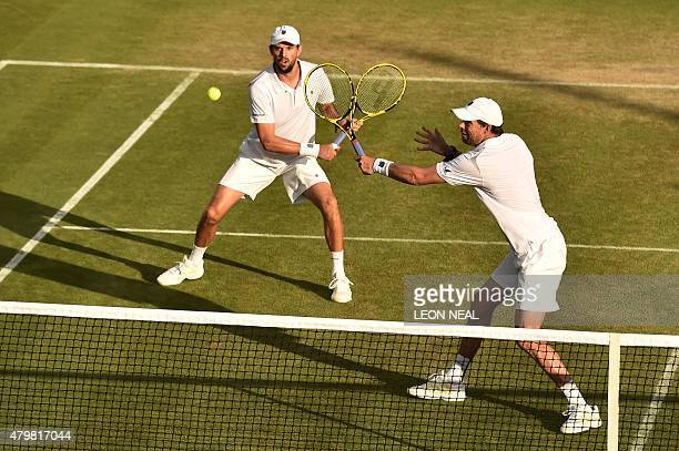 US player Mike Bryan and his partner Bob Bryan return against India's Rohan Bopanna and Romania's Florin Mergea during their men's quarterfinals...