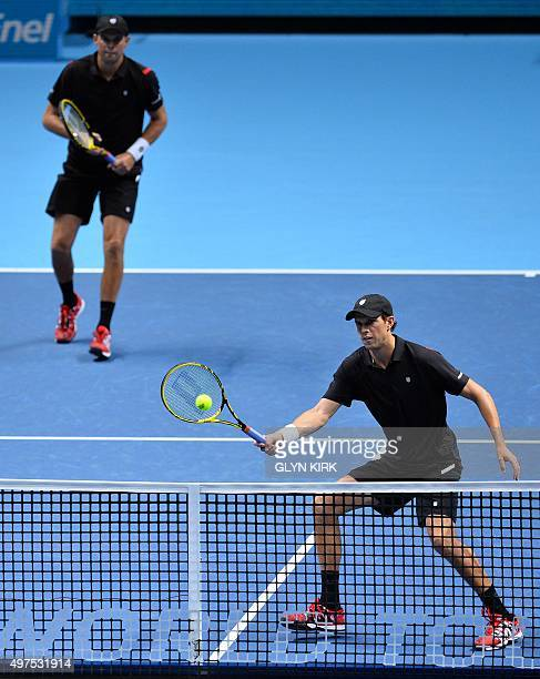 US player Mike Bryan and US player Bob Bryan in their match against Italy's Simone Bolelli and Fabio Fognini during their men's doubles group stage...