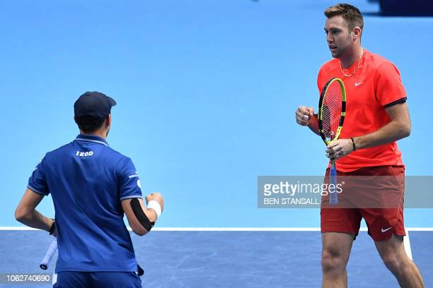 US player Mike Bryan and US player Jack Sock react against Britain's Jamie Murray and Brazil's Bruno Soares during their men's doubles semifinal...
