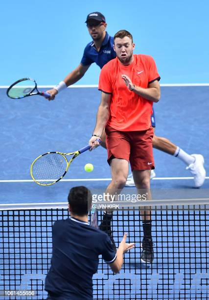 US player Mike Bryan and US player Jack Sock react as Austria's Oliver Marach and Croatia's Mate Pavic return during their men's doubles roundrobin...