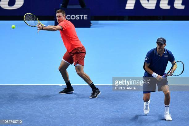 US player Mike Bryan and US player Jack Sock return against Britain's Jamie Murray and Brazil's Bruno Soares during their men's doubles semifinal...