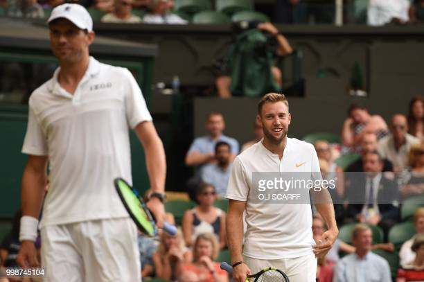 US player Mike Bryan and US player Jack Sock win a point against South Africa's Raven Klaasen and New Zealand's Michael Venus during their mens'...