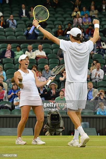 US player Mike Bryan and US player Lisa Raymond celebrate their mixed doubles final victory over India's Leander Paes and Russia's Elena on day 13 of...