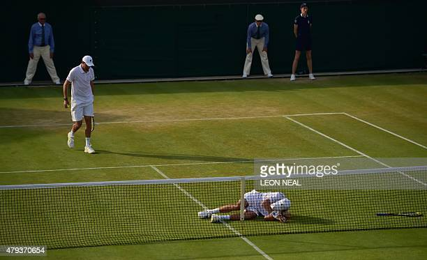 US player Mike Bryan lies at the net after he was hit by the ball from the service of his partner US player Bob Bryan during their men's doubles...