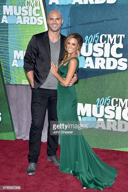 NFL player Mike Caussin and singer Jana Kramer attend the 2015 CMT Music awards at the Bridgestone Arena on June 10 2015 in Nashville Tennessee