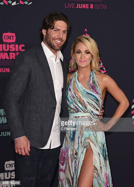 NHL player Mike Fisher and singersongwriter Carrie Underwood attend the 2016 CMT Music awards at the Bridgestone Arena on June 8 2016 in Nashville...