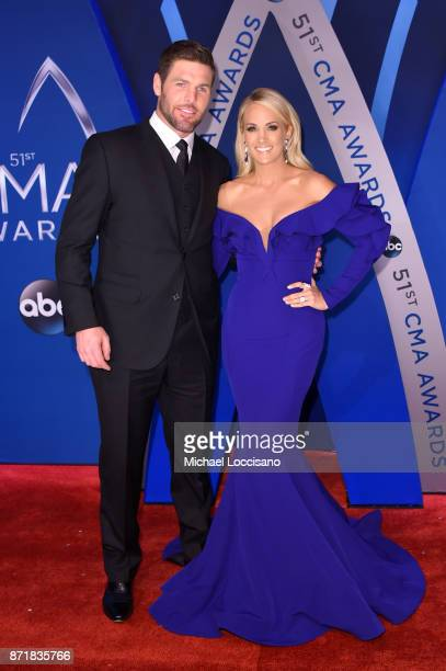 NHL player Mike Fisher and singersongwriter Carrie Underwood attend the 51st annual CMA Awards at the Bridgestone Arena on November 8 2017 in...