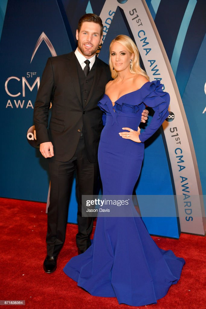NHL player Mike Fisher and singer-songwriter Carrie Underwood attend the 51st annual CMA Awards at the Bridgestone Arena on November 8, 2017 in Nashville, Tennessee.