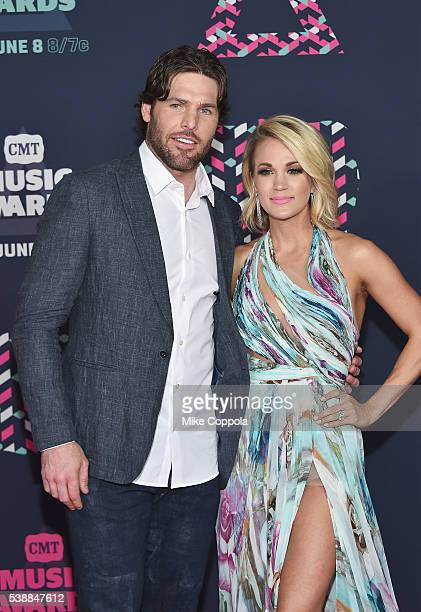 NHL player Mike Fisher and singersongwriter Carrie Underwood attends the 2016 CMT Music awards at the Bridgestone Arena on June 8 2016 in Nashville...