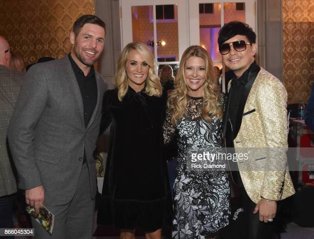NHL Player Mike Fisher singersongwriter Carrie Underwood Tracie Hamilton of J/P HRO and host Newman Arndt attend Nashville Shines for Haiti...