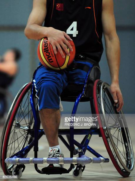 Player moves up court with the ball as Chinese wheelchair basketball players attend a training session on September 2, 2008 at the National Indoor...