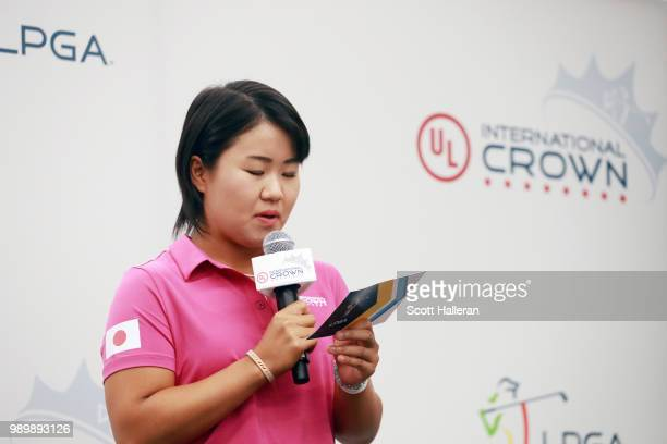 LPGA player Nasa Hataoka of Japan reads the names of her Japanese team players on stage at the UL International Crown Press Conference on July 2 2018...
