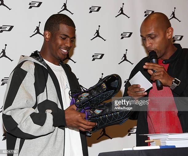 NBA player New Orleans Hornets point guard Chris Paul is being interviewed by moderator Ermias Amiaz Habtu during an instore appearance at the...