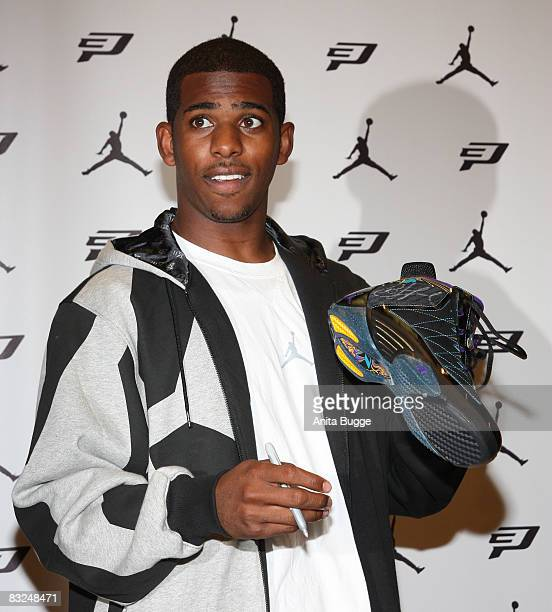 NBA player New Orleans Hornets point guard Chris Paul puts his signature on the 'Air Jordan CP3 signature shoes' during an instore appearance at the...