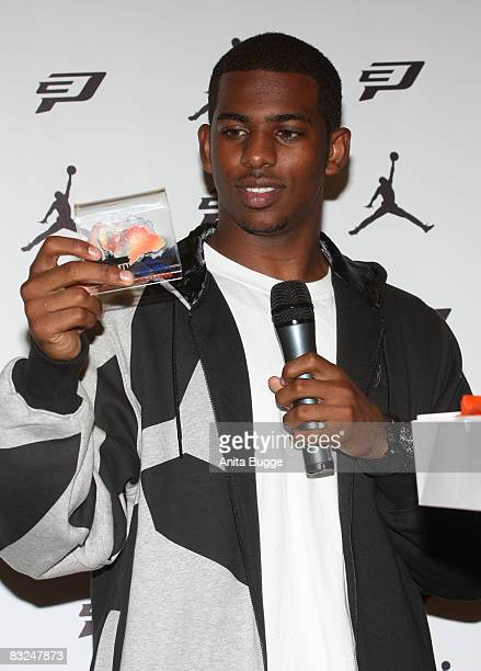 NBA player New Orleans Hornets point guard Chris Paul receives a little piece of the Berlin wall during an instore appearance at the Niketown store...