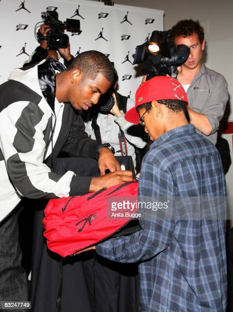 NBA player New Orleans Hornets point guard Chris Paul signs autographs during an instore appearance at the Niketown store on October 13 2008 in...