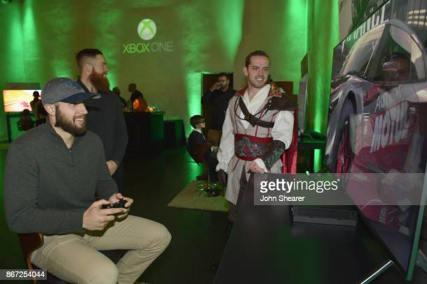 NHL player Nick Bonino and Ryan Ellis test out the new games at the Xbox Halloween Gaming Event hosted by Brad Paisley and Kimberly WilliamsPaisley...