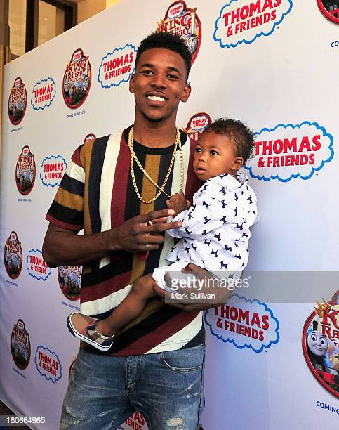 """Player Nick Young and son attend the """"Thomas & Friends: King of the Railway"""" blue carpet premiere at The Grove on September 15, 2013 in Los Angeles,..."""