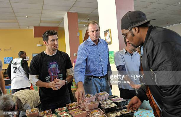 PLayer Nomar Garciaparra and Master of Ceremonies Jay Bilas pass out food to residents of the Tenderloin district at the Feeding America Food Bank on...