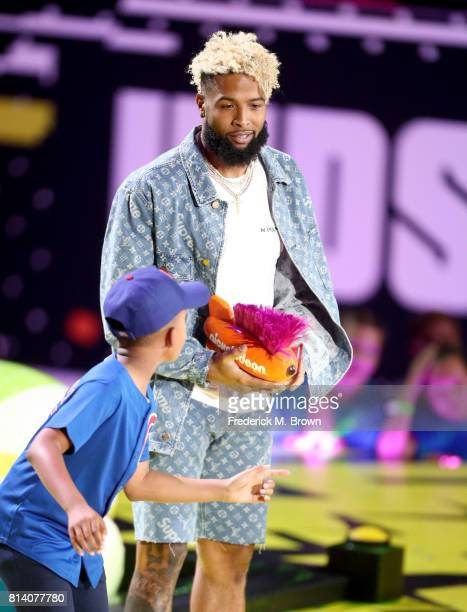 NFL player Odell Beckham Jr accepts the award for 'Hands of Gold' onstage during Nickelodeon Kids' Choice Sports Awards 2017 at Pauley Pavilion on...