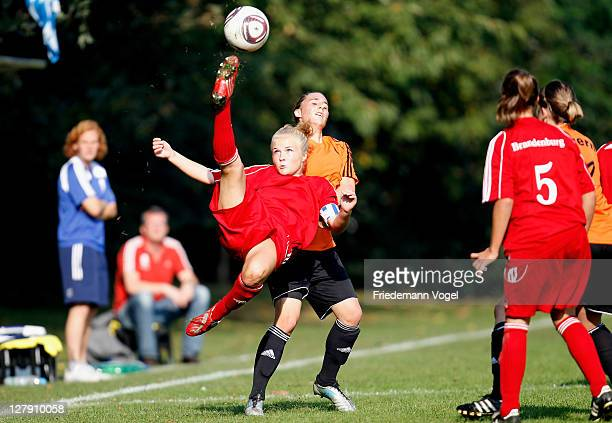 A player of Bayern and a player of Brandenburg battle for the ball during the decision match between Rheinland and Mittelrhein during the Women's U17...