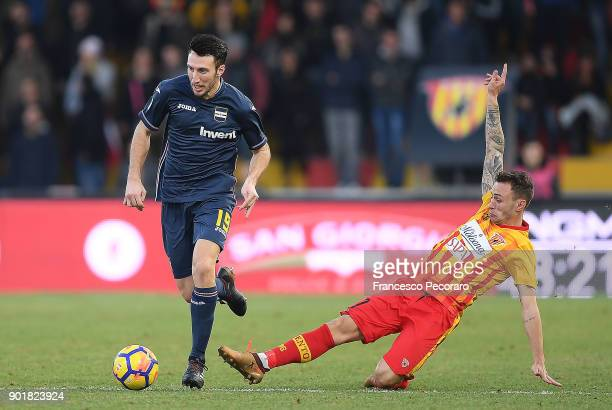 Player of Benevento Calcio Cristiano Lombardi vies with UC Sampdoria player Vasco Regini during the serie A match between Benevento Calcio and UC...