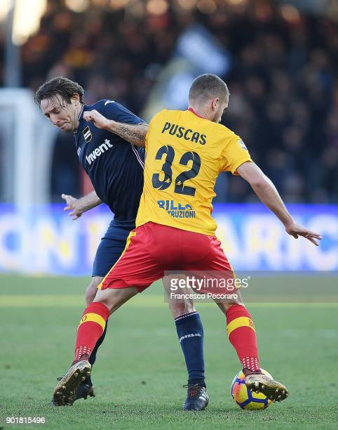 Player of Benevento Calcio George Puscas vies with UC Sampdoria player Edgar Barreto during the serie A match between Benevento Calcio and UC...