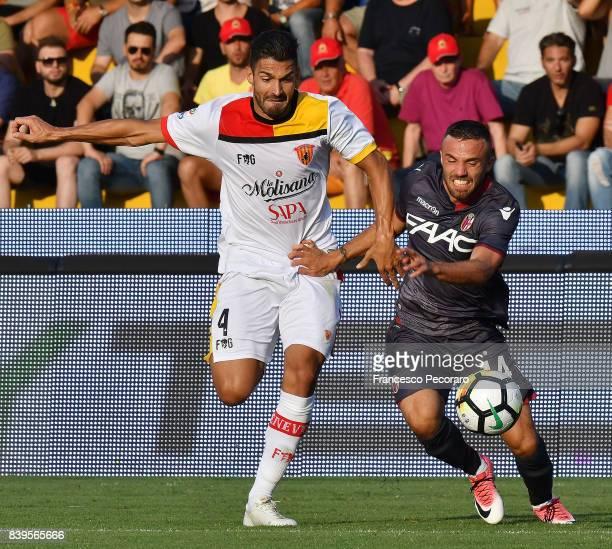 Player of Benevento Calcio Lorenzo Del Pinto vies with Bologna FC player Federico Di Francesco during the Serie A match between Benevento Calcio and...