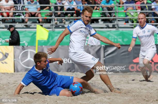 A player of Berlin and a player of Rostock battle for the ball during the half final match between Hertha BSC and Rostocker Robben on day 2 of the...