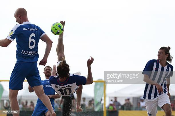 Player of Berlin and Player of Rostock compete for the ball during the first round match between Rostocker Robben and Hertha BSC Berlin on day 1 of...