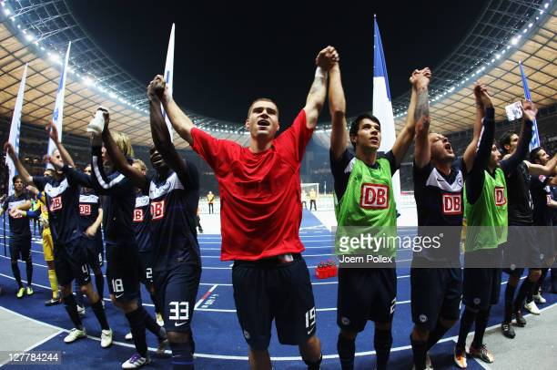 Player of Berlin celebrate after winning the Bundesliga match between Hertha BSC Berlin and 1. FC Koeln at Olympic Stadium on October 1, 2011 in...