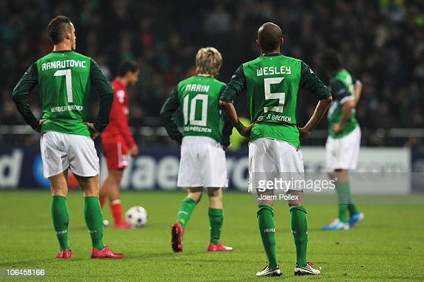 Player of Bremen are seen after Nacer Chadli of Twente scored his team's first goal during the UEFA Champions League group A match between SV Werder...