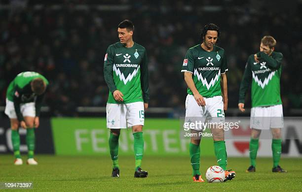 Player of Bremen are seen after Simon Rolfes of Leverkusen scored his team's second goal during the Bundesliga match between Werder Bremen and Bayer...