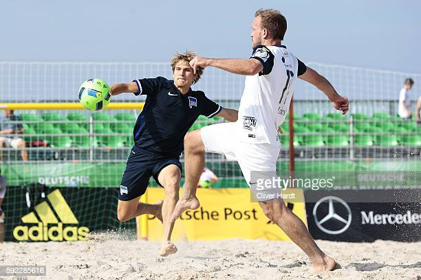 Player of Chemnitz and Player of Berlin compete for the ball during the first round match between BST Chemnitz and Hertha BSC Berlin on day 1 of the...
