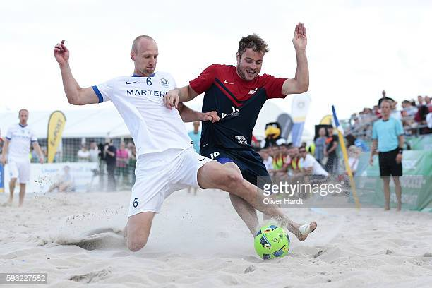 Player of Chemnitz and Player of Rostock compete for the ball during the third place match between BST Chemnitz and Rostocker Robben on day 2 of the...