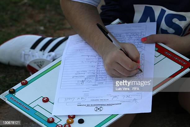 Player of Colegio del Sol signs the schedule of game before the FIFA Women's Football Initiative on October 27 2011 in Asuncion Paraguay