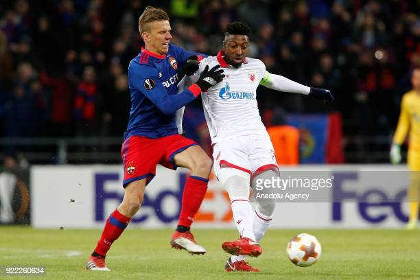 A player of Crvena Zvezda and a player of CSKA Moscow vie for the ball during the UEFA Europa League round of 32 second leg soccer match between CSKA...