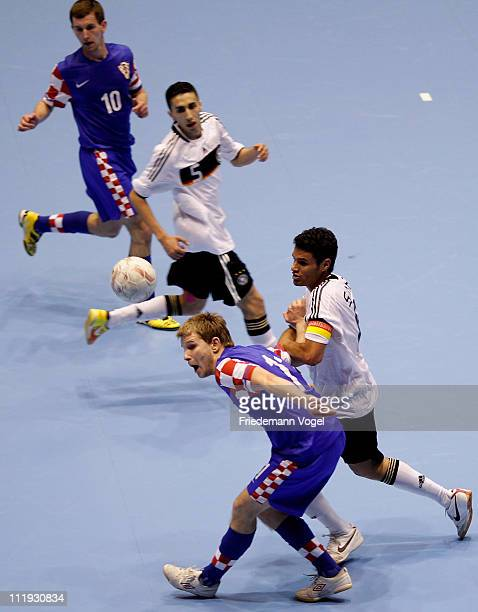 A player of DFB Allstars and a player of Croatia battle for the ball during the DFB Futsal Cup at ring arena on April 9 2011 in Nuerburg Germany