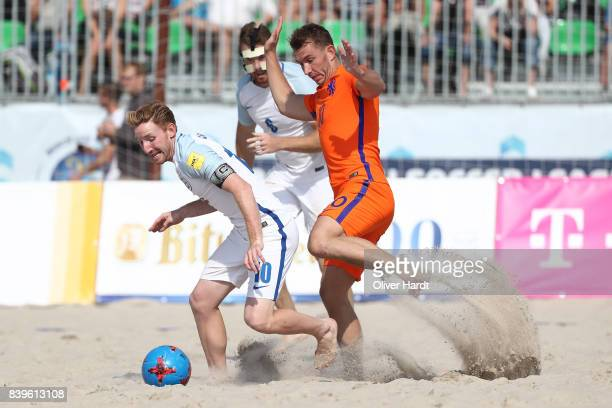 Player of England and Player of Netherlands compete for the ball during Euro Beach Soccer League match Day two between Ukraine and Germany on August...