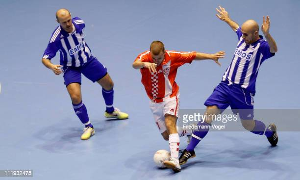 A player of FC Bayern Kickers Nuernberg and a player of SD Croatia Berlin battle for the ball during the final match of the DFB Futsal Cup at ring...