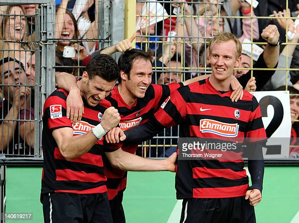 Player of Freiburg celebrates after Daniel Caligiuri is scoring his teams second goal with a penalty during the Bundesliga match between SC Freiburg...