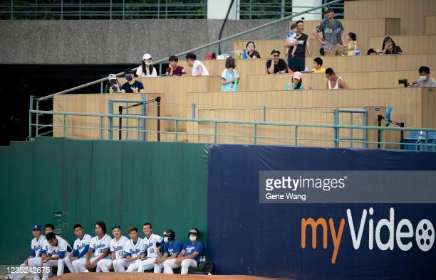 Player of Fubon Guardians seat at the courtside during the CPBL game between Fubon Guardians and CTBC Brothers at the Xinzhuang Baseball Stadium on...