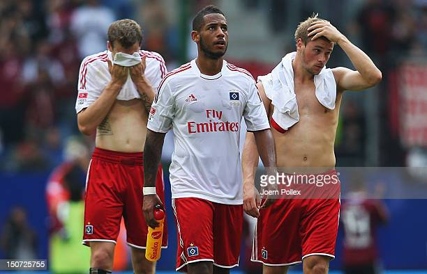 Player of Hamburg are seen disappointed after the Bundesliga match between Hamburger SV and 1 FC Nuernberg at Imtech Arena on August 25 2012 in...