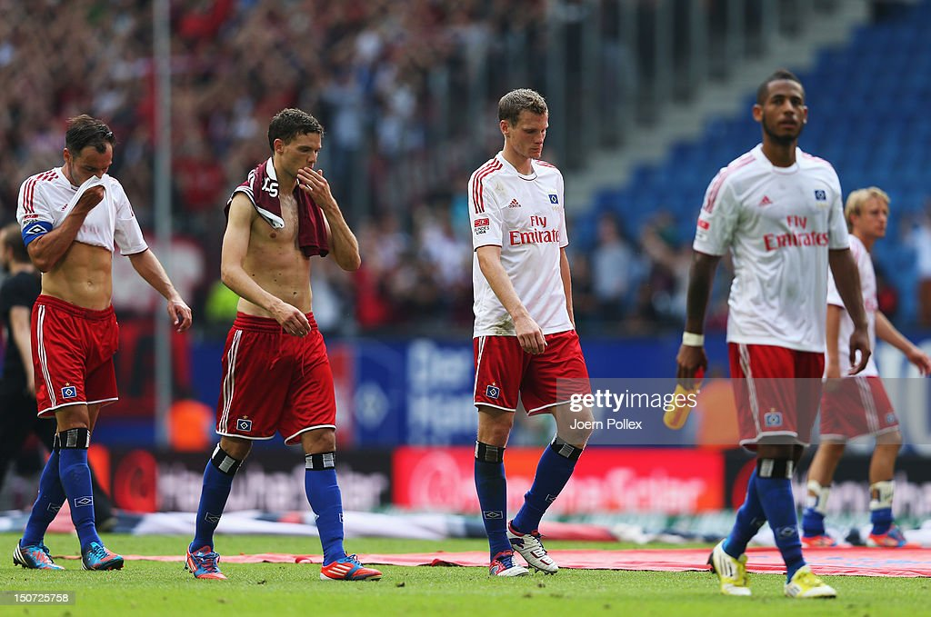 Player of Hamburg are seen disappointed after the Bundesliga match between Hamburger SV and 1. FC Nuernberg at Imtech Arena on August 25, 2012 in Hamburg, Germany.