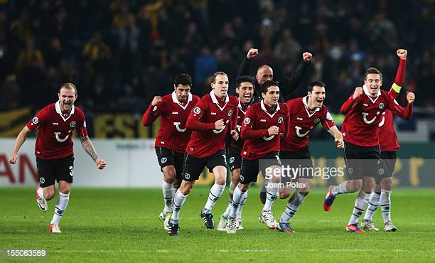 Player of Hannover celebrate afer winning during the second round DFB Cup match between Hannover 96 and Dynamo Dresden at AWD Arena on October 31...