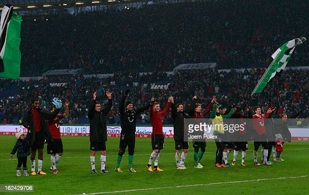 Player of Hannover celebrate after the Bundesliga match between Hannover 96 and Hamburger SV at AWD Arena on February 23 2013 in Hannover Germany