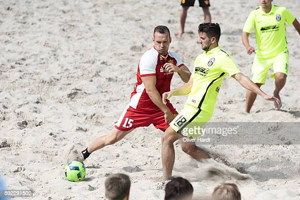 Player of Hohensee and Player of Ibbenbuerener compete for the ball during the first round match between Ibbenbuerener BSC and Hohensee United on day...